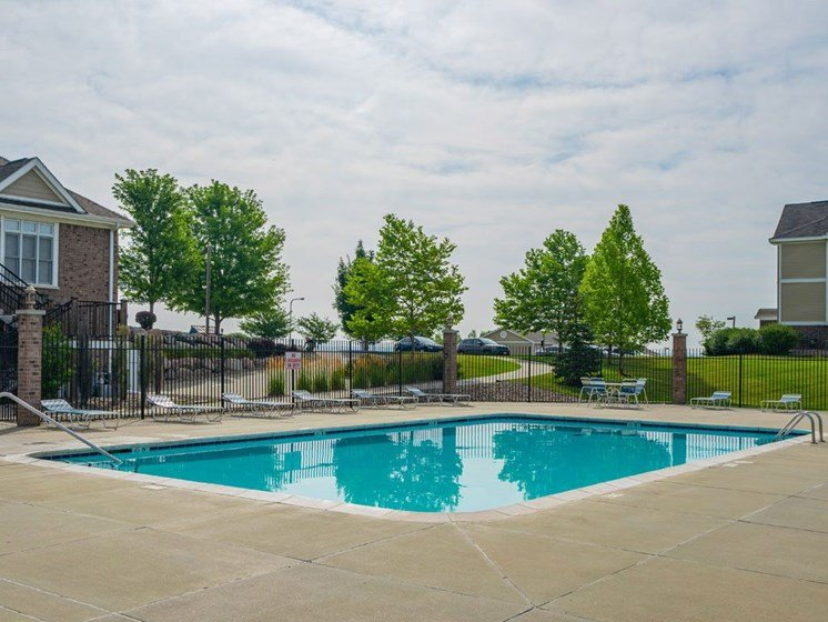 Relaxing Pool Area With Sundeck at Colonial Pointe at Fairview Apartments, Bellevue