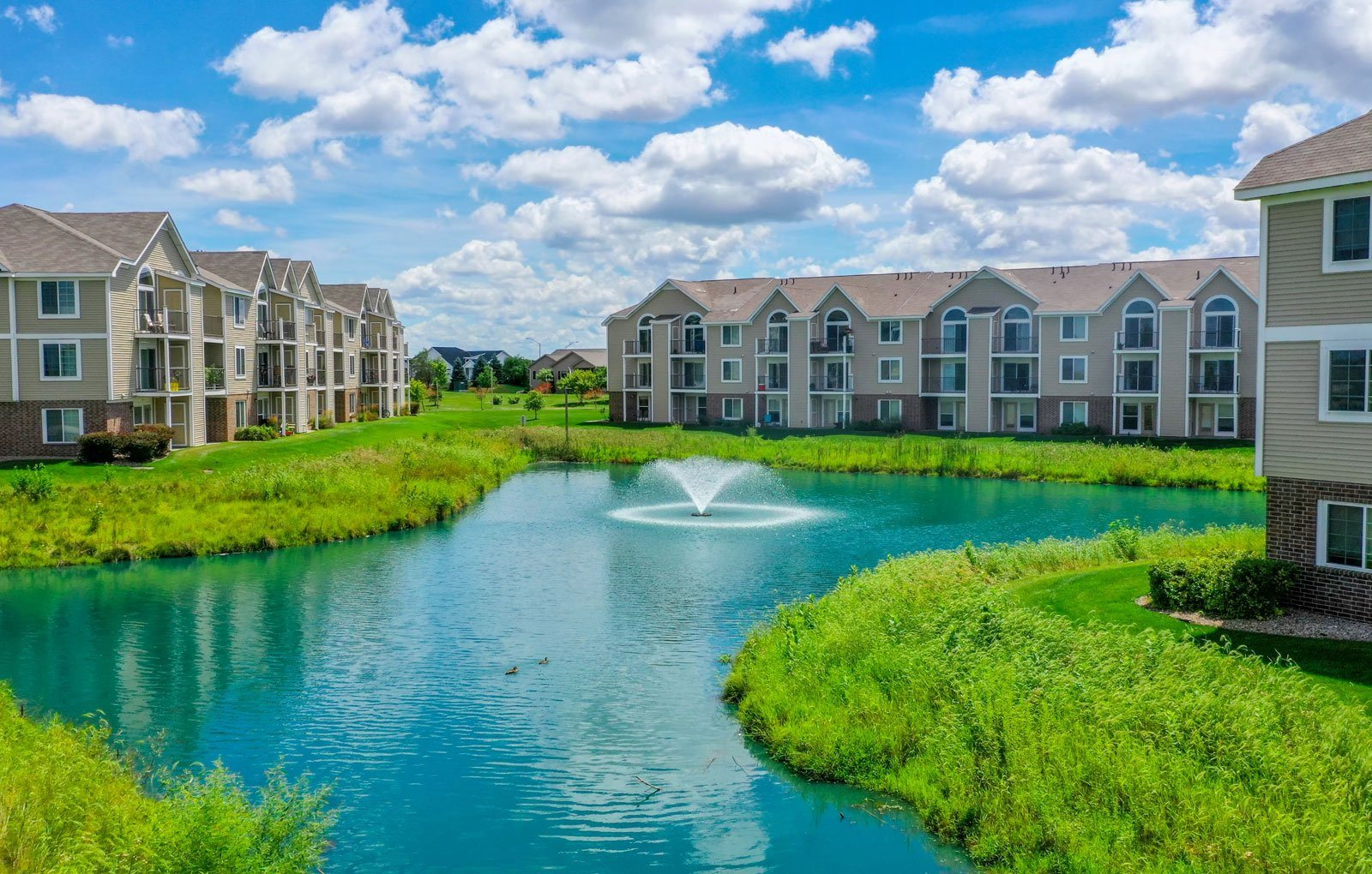 Stunning Community Lake and Lakeside Apartments at Fieldstream Apartment Homes, Iowa