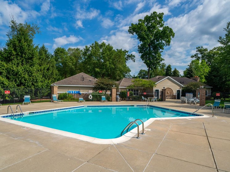 Outdoor Pool with Lounge Chairs at The Highlands Apartments, Indiana
