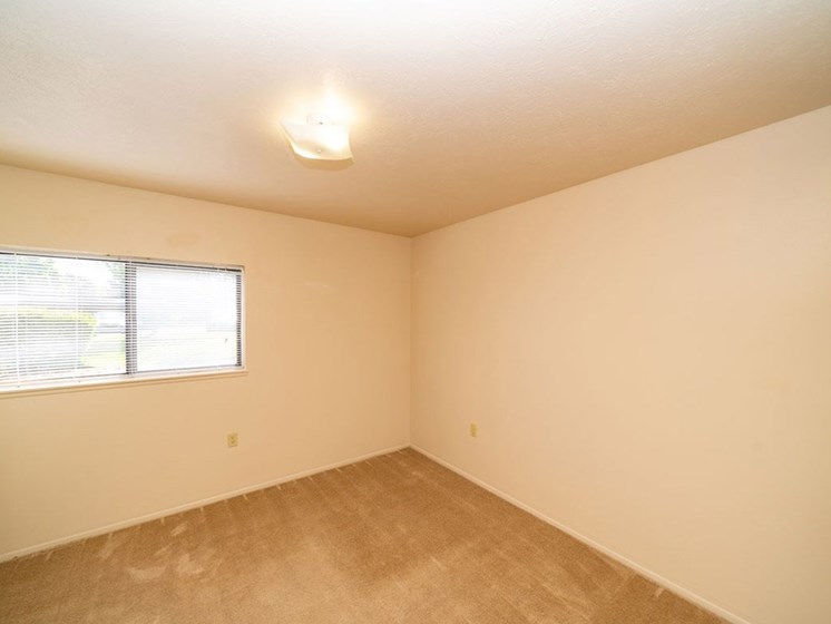 Residential Room With Window at North Pointe Apartments, Elkhart, Indiana