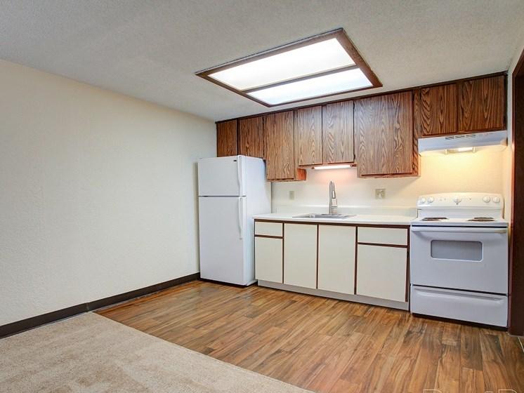 Kitchen area with vinyl and white appliances