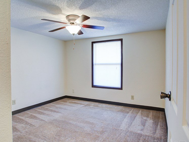 Bedroom with window and ceiling fan