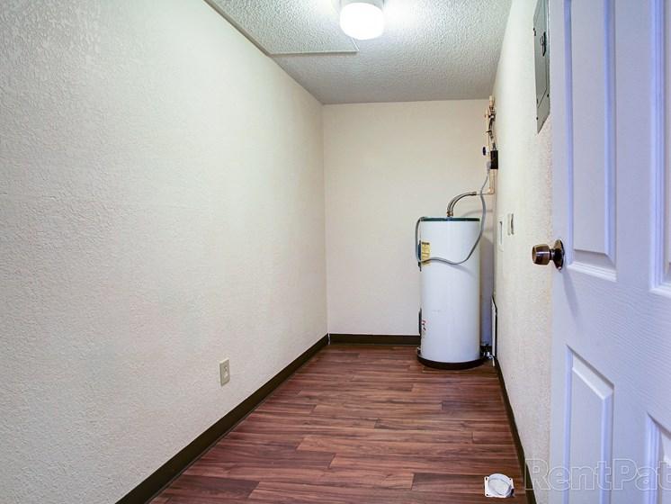 Storage area with vinyl flooring and attic door