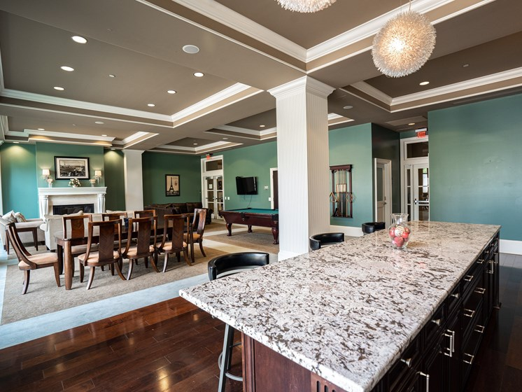 Overview of the kitchen and dinning area at the Club Room at the Residences of Creekside.