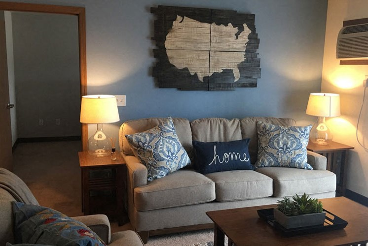 Living room couch with blue decor