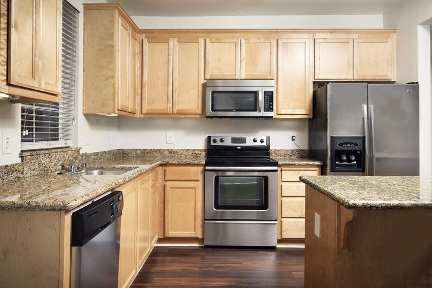 Apartments San Jose, CA - Aviara Apartments Fully Equipped Kitchen with Wooden Cabinetry and Energy Efficient Appliances