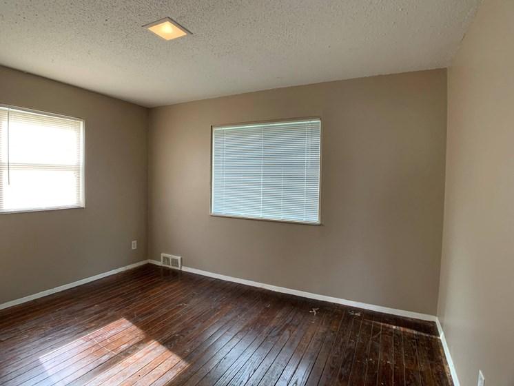room with hardwood floors and windows