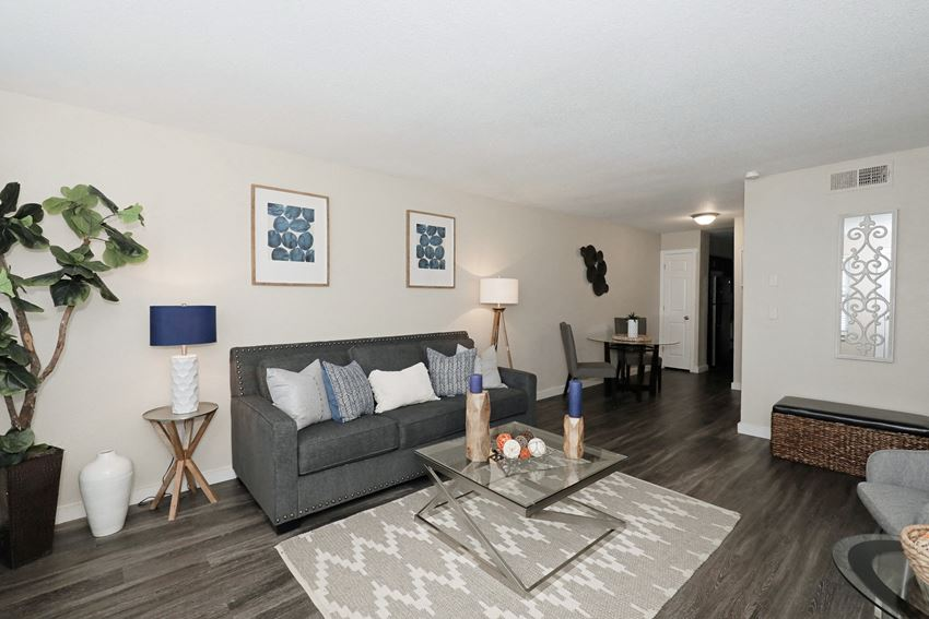 Photo of living room with couch, coffee table, and chair