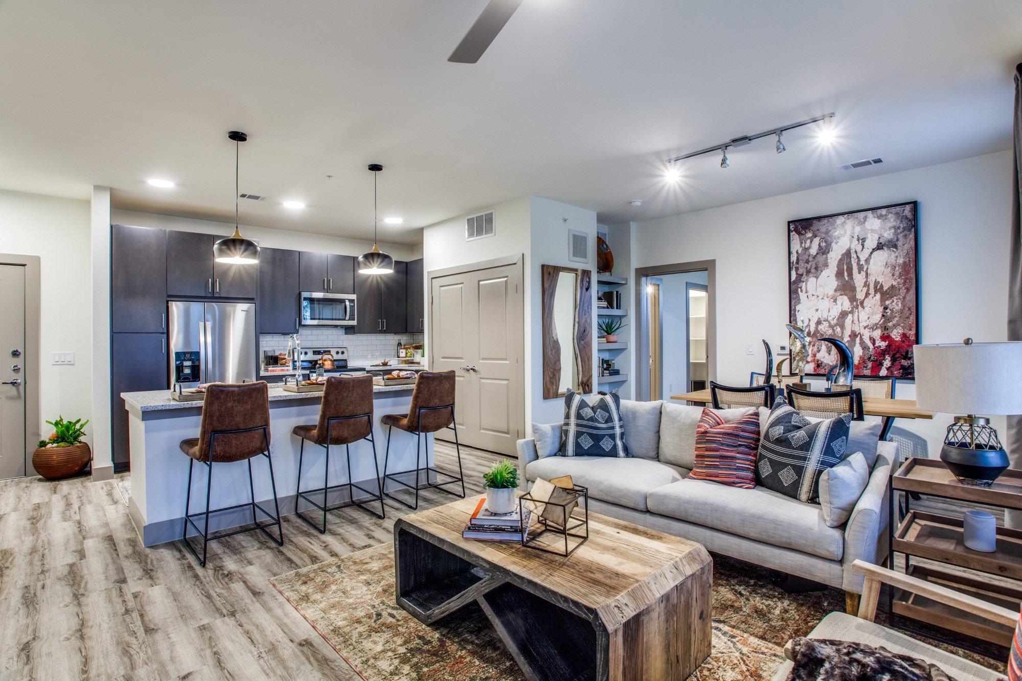 Aura Benbrook Apartments Model Living Room and Kitchen
