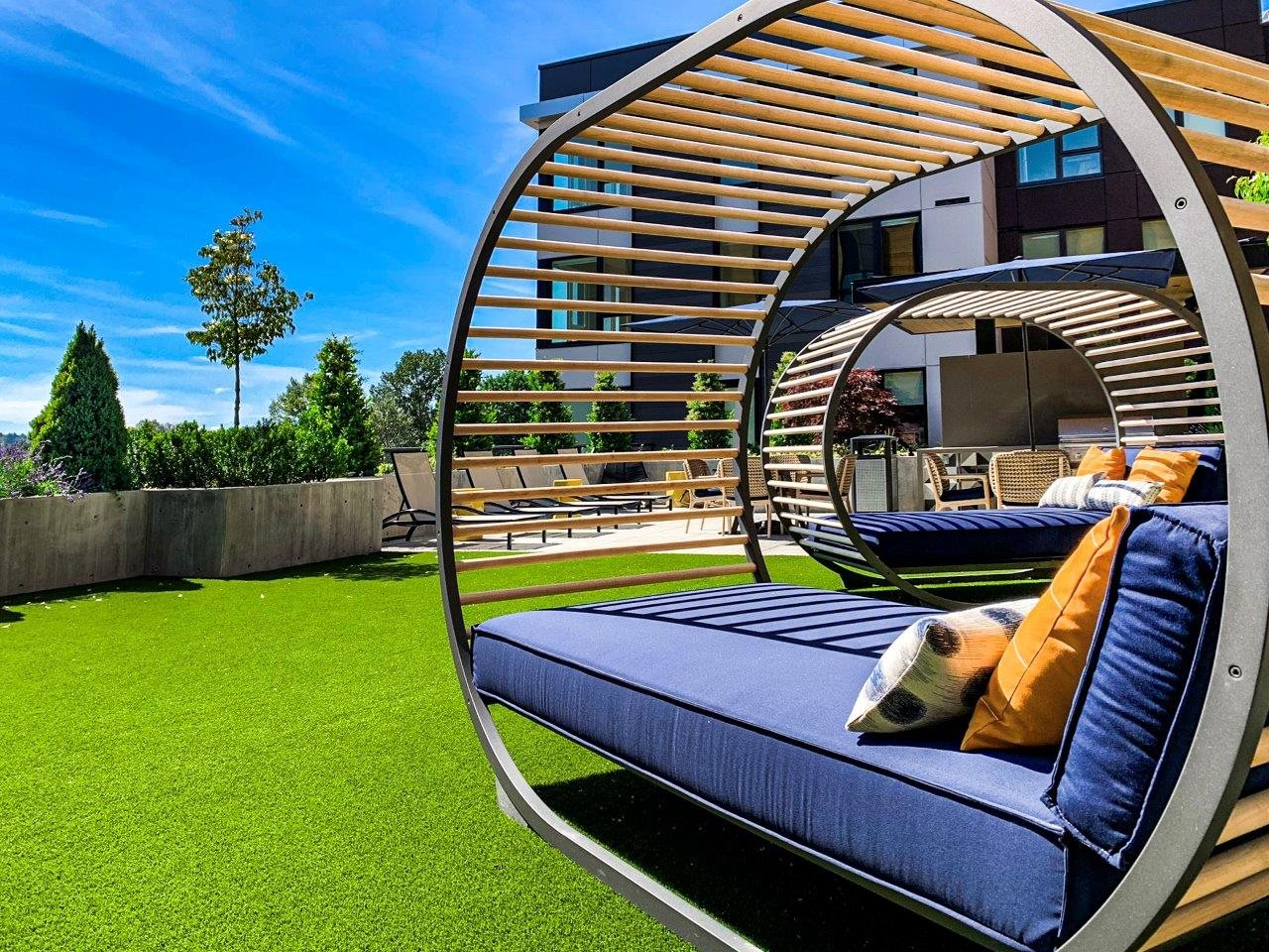 Aura Totem Lake Apartments Rooftop Courtyard and Covered Lounge Chairs