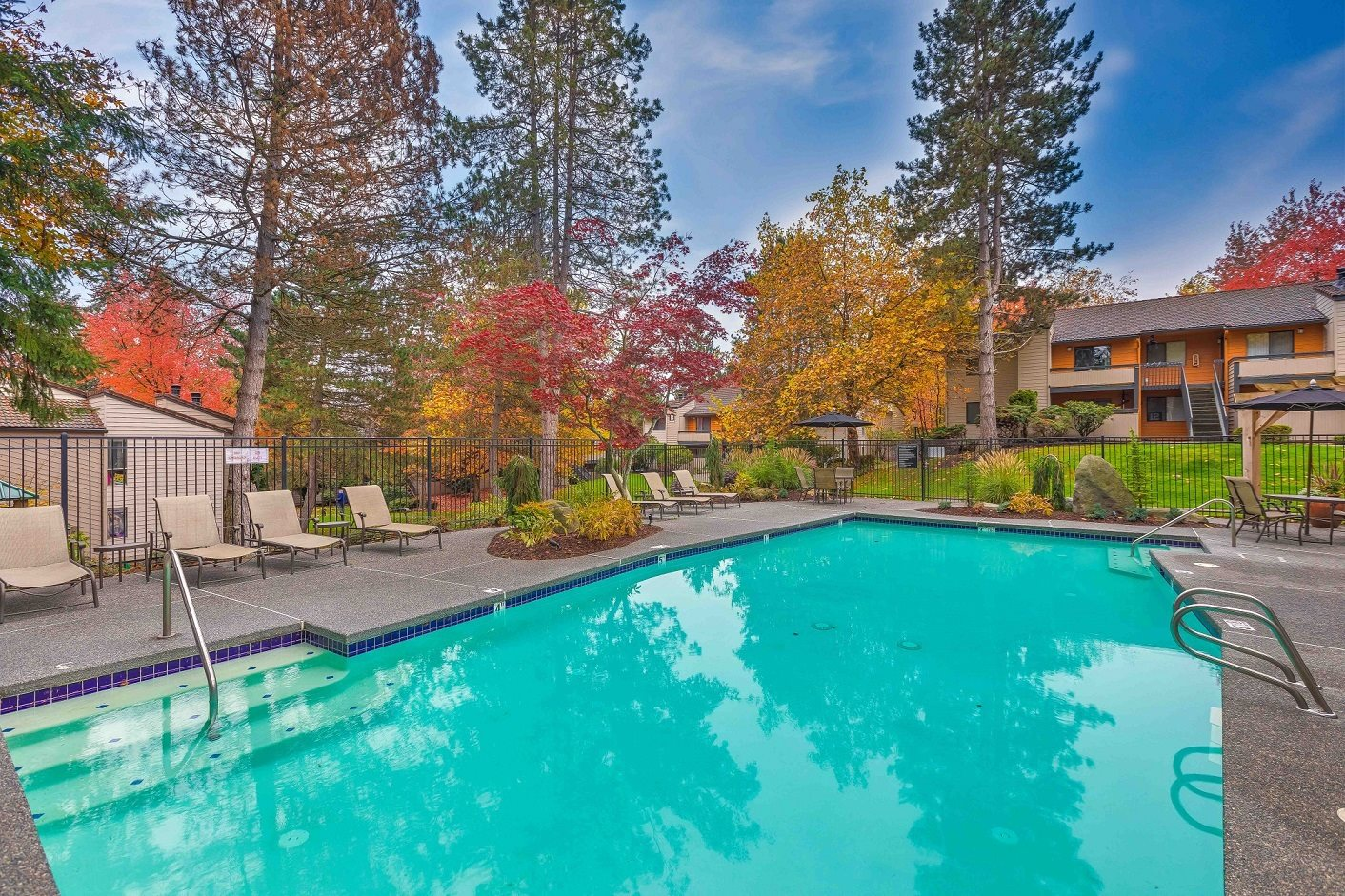 Lynnwood Apartments for Rent - Alderwood Park Swimming Pool With Lush Landscaping and Poolside Seating