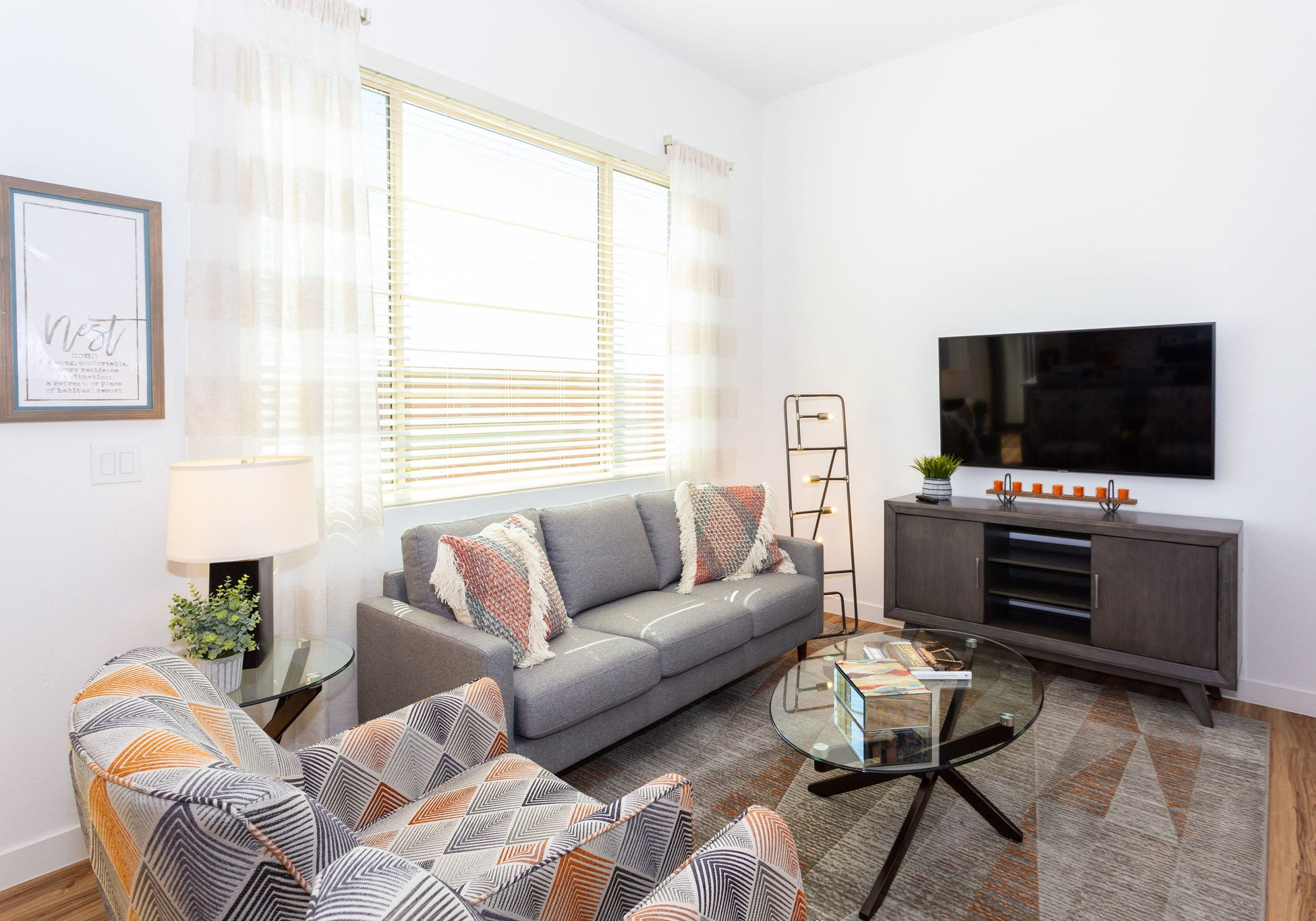 Apartments for Rent in Mesa, AZ - Hampton East Naturally Lit Living Room with Hardwood-Style Plank Flooring and Large Window