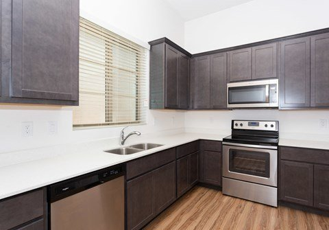 One and Two Bedroom Apartments in Mesa, AZ - Hampton East Kitchen with Stainless Steel Appliances and Dining Room SeatingOne and Two Bedroom Apartments in Mesa, AZ - Hampton East Kitchen with Stainless Steel Appliances and Dining Room Seating
