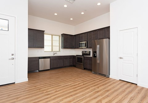 One and Two Bedroom Apartments in Mesa, AZ - Hampton East Kitchen with Stainless Steel Appliances and Dining Room Seating