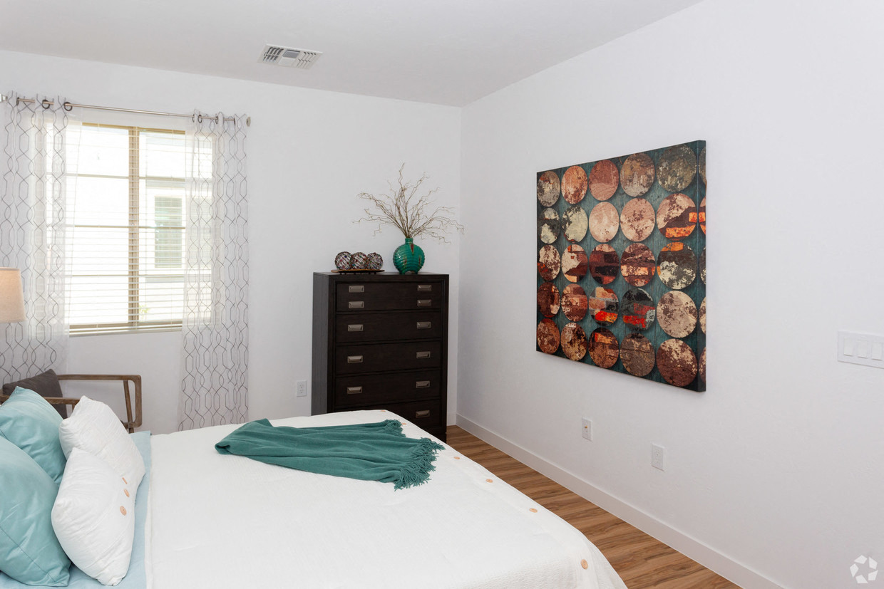 Luxury One Bedroom Apartments in Mesa, AZ - Hampton East Apartments Bedroom with Large Window and Wood Flooring