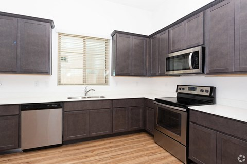 Luxury Apartments in Mesa for Rent - Hampton East Apartments Kitchen with Stainless Steel Appliances and Ample Cabinet and Counter Space
