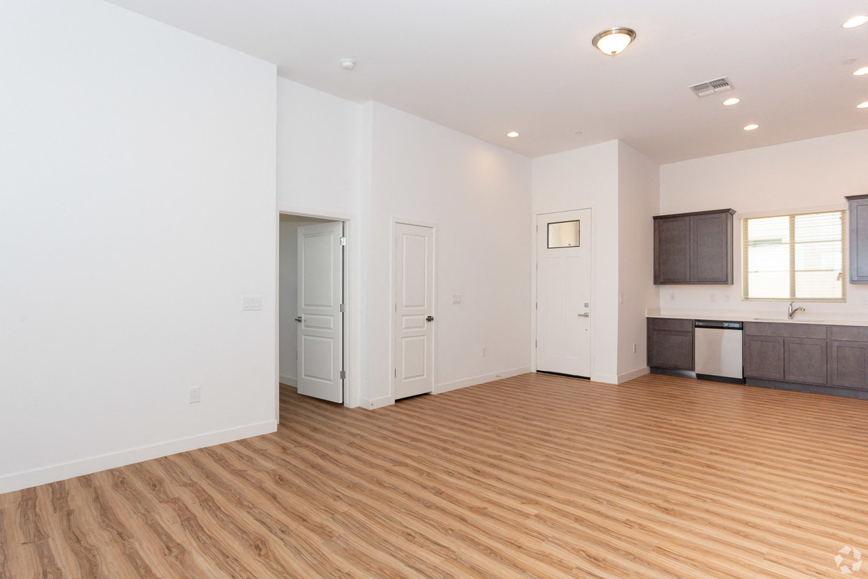 Luxury Apartments in Mesa - Hampton East Apartments Spacious Open-Concept Living Room with Wood Flooring