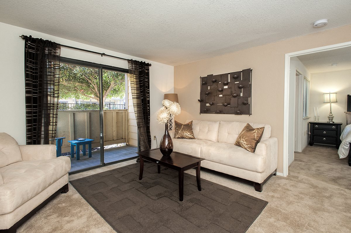 Bishops Court Apartments Furnished Model Living Room & Patio