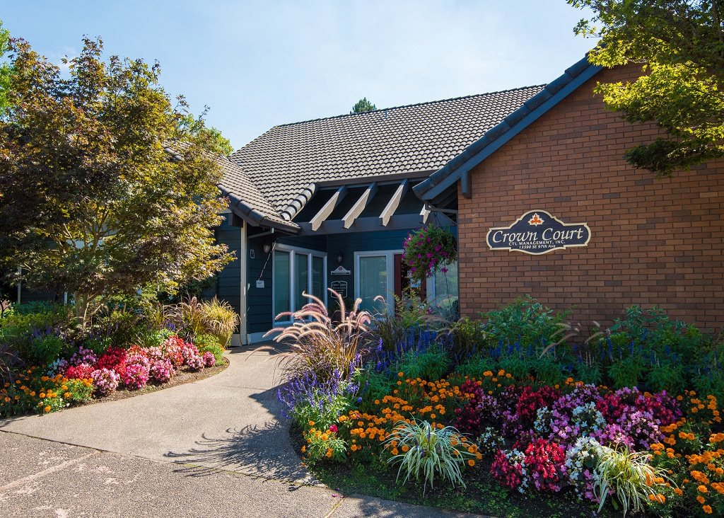 Crown Court Clubhouse Exterior Entry & Floral Landscaping