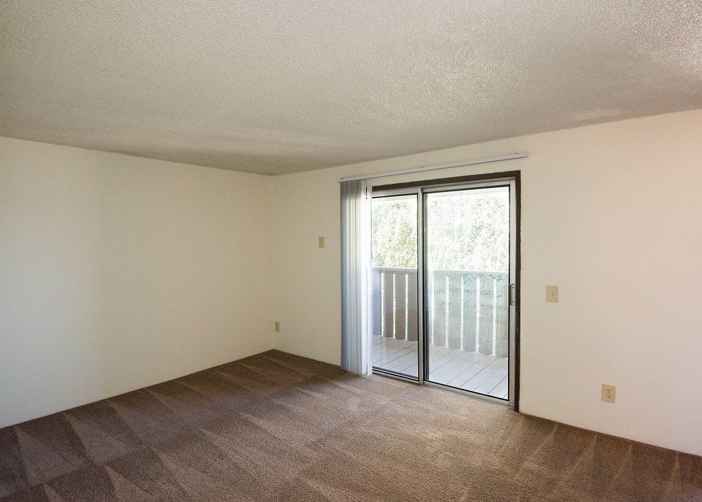 Rolling Hills Vacant Apartment Living Room & Sliding Door to Deck