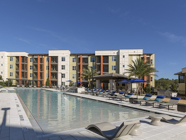 Poolside Sundeck With Relaxing Chairs at Integra Sunrise Parc, Florida