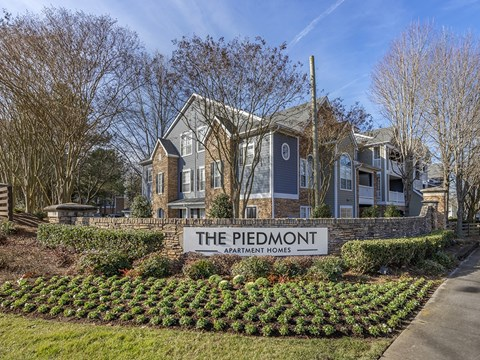 The Piedmont Exterior Signage with landscaping around