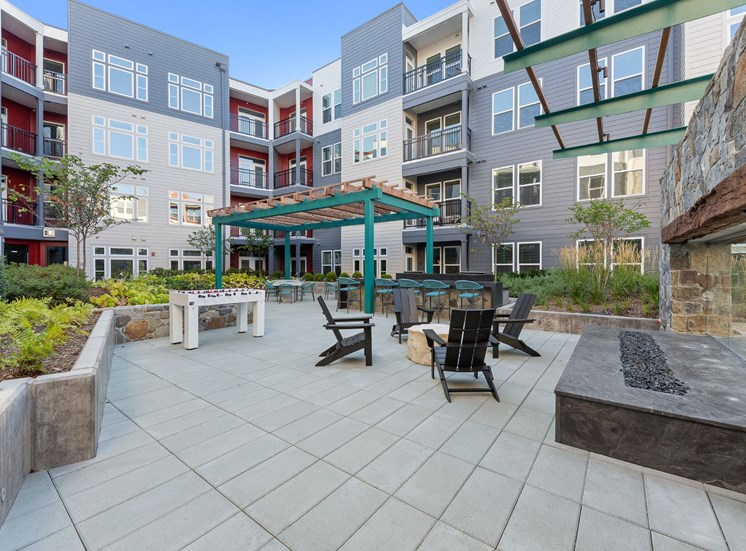 Outdoor Lounge Area With Fireplace at Cameron Square, Alexandria, Virginia