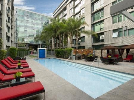 Resort-Inspired Lap Pool With Sundeck at Met Lofts, Los Angeles, CA, 90015