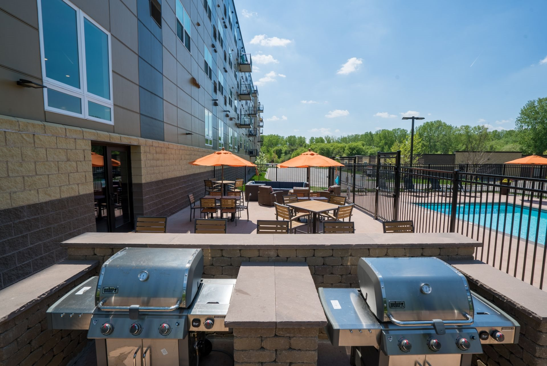 Poolside Outdoor Kitchen with Grilling Stations, Berkshire Central Apartments- 9436 Ulysses Street NE  Blaine, MN.  55434