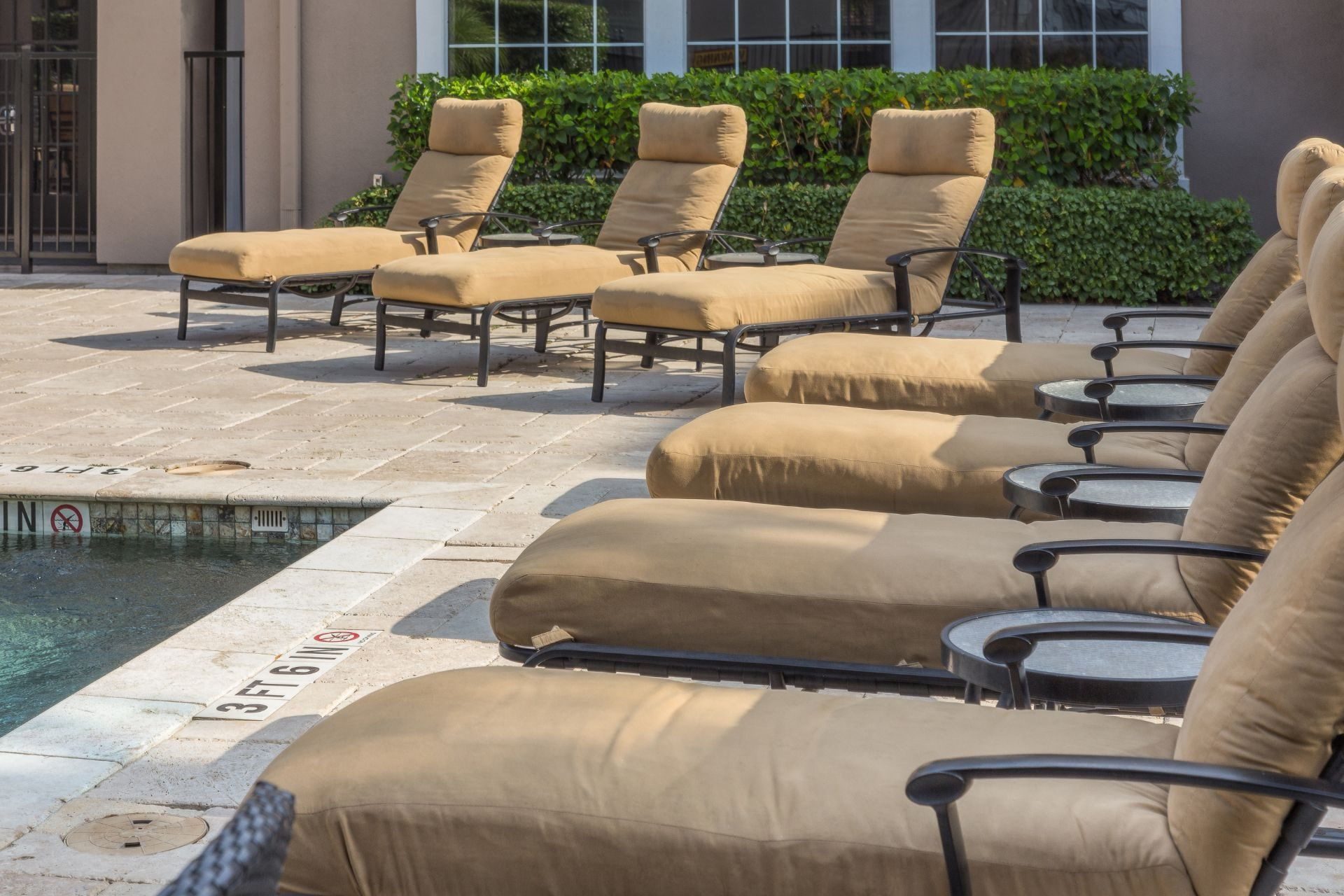 Poolside Relaxing Area at Estates at Bellaire, Texas
