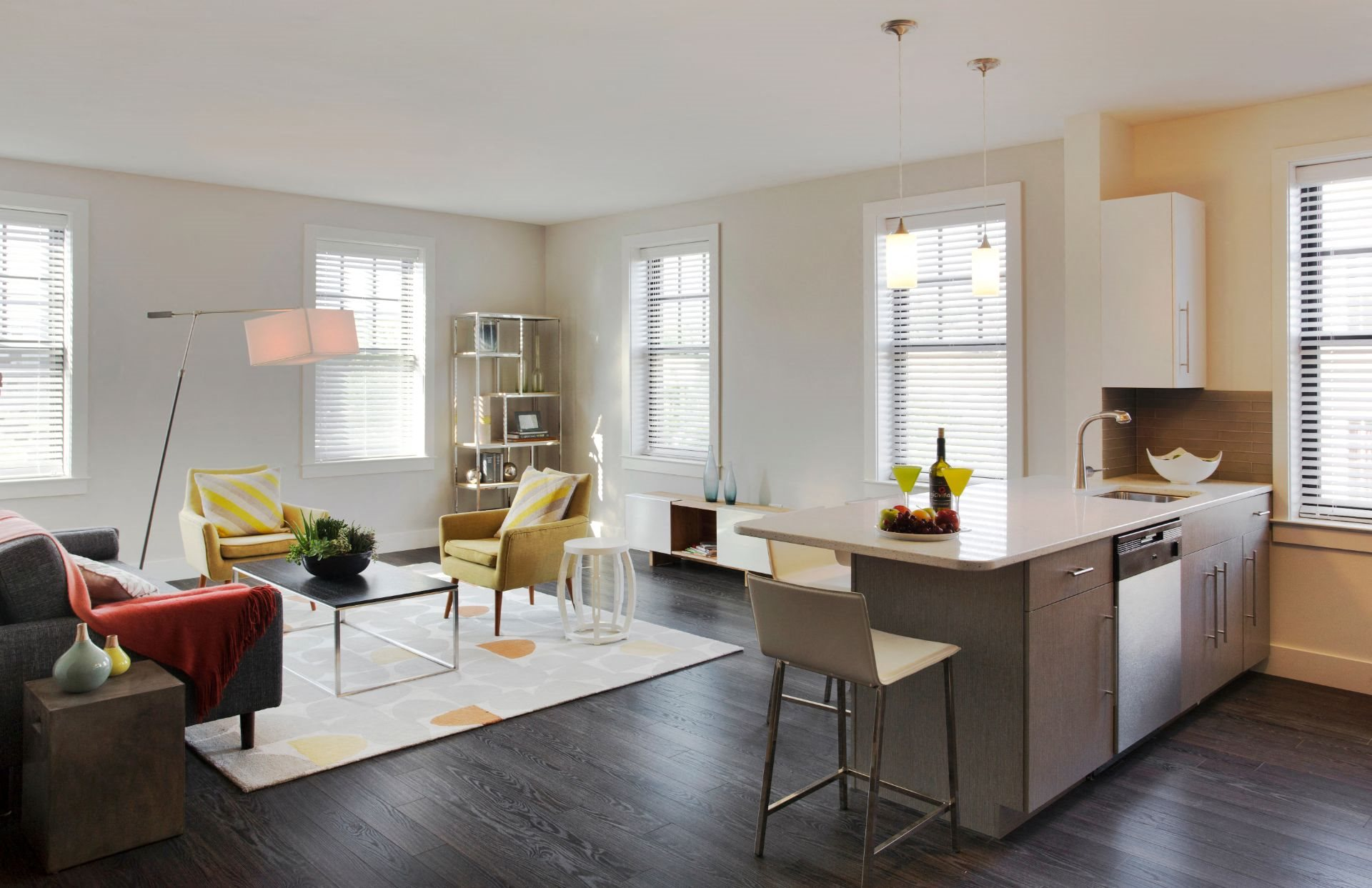 Interior Kitchen with Prep Island and Open-Concept Living and Dining Area at Gatehouse 75, Charlestown, 02129