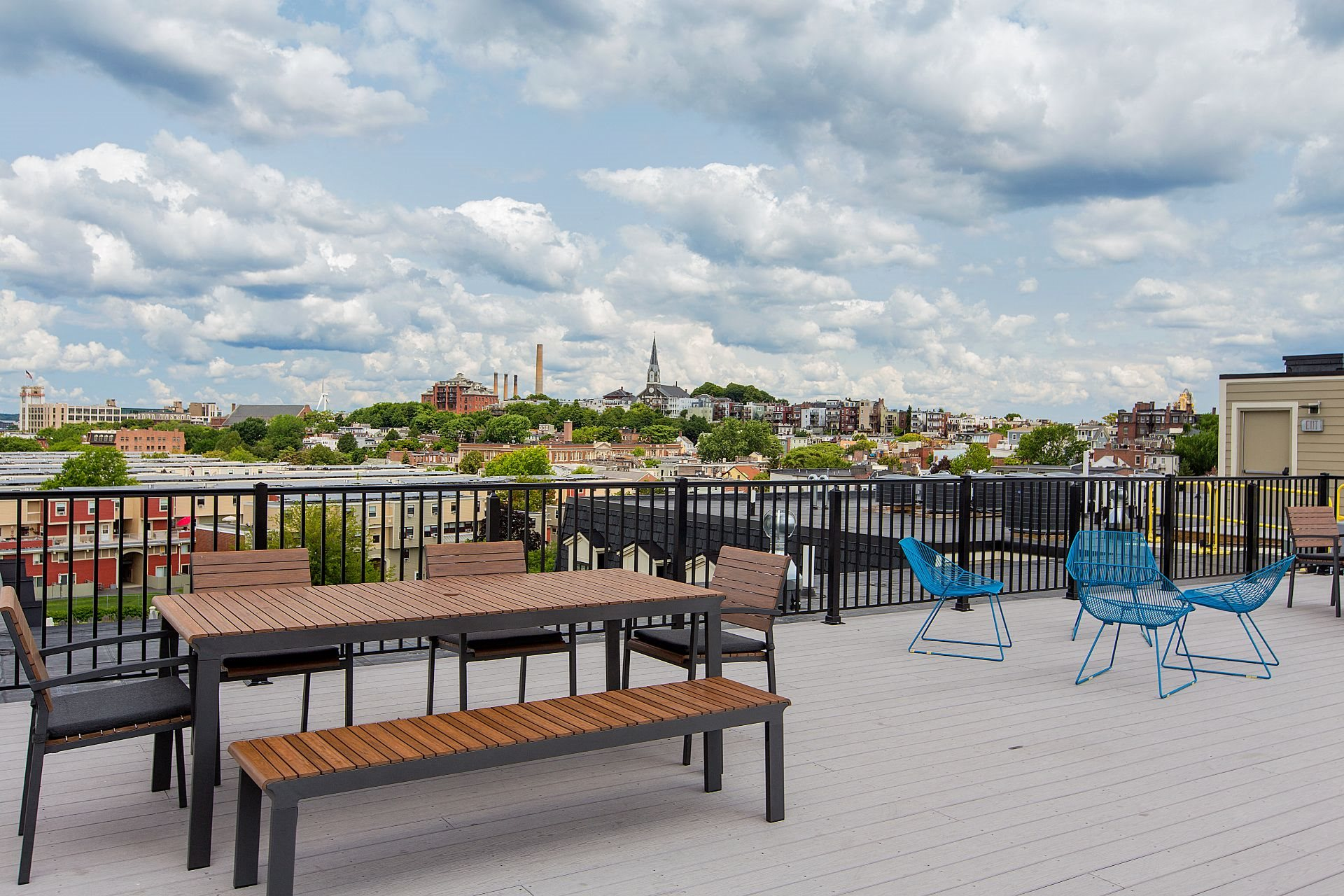 Rooftop Skydeck with Al Fresco Dining and Work-From-Home Spaces and  Stunning Views of Downtown Boston and Zakim Bridge at Gatehouse 75, Charlestown, Massachusetts