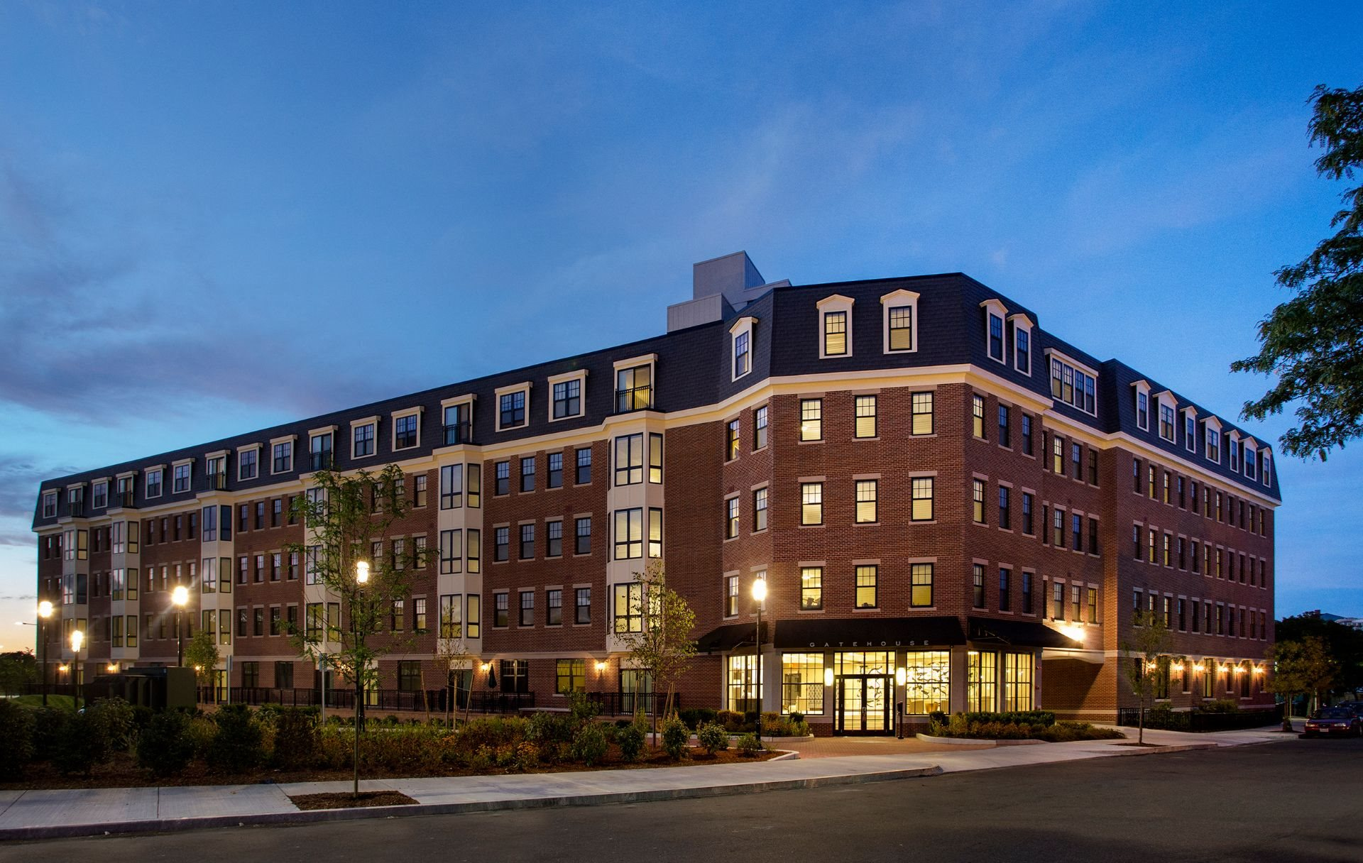 Exterior 5-Story Building at Dusk with Beautiful Controlled Access Entrance and Garage Parking Entrance at Gatehouse 75, Charlestown, Massachusetts