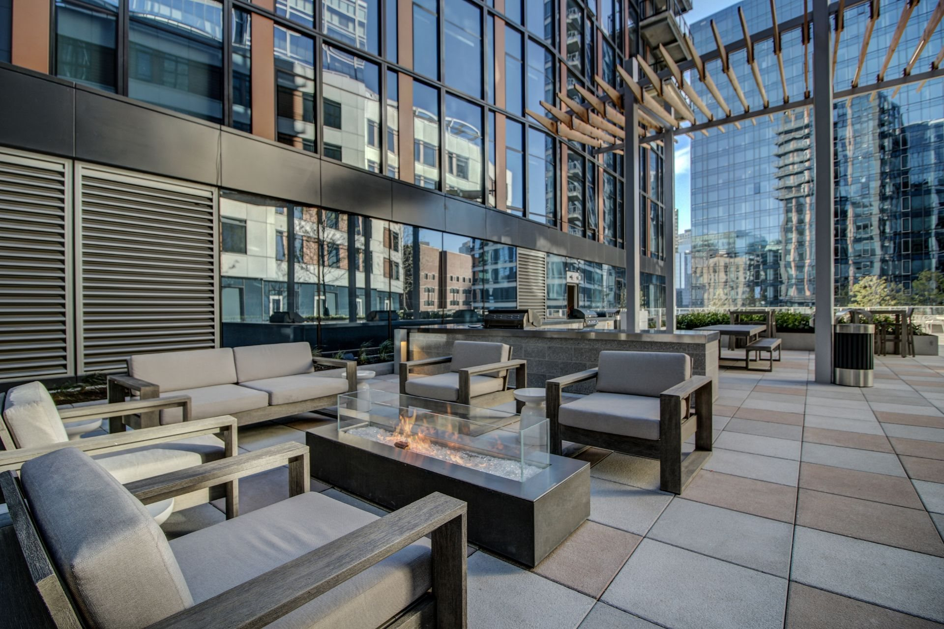 Outdoor courtyard with fire pit at Via Seaport Residences, Massachusetts