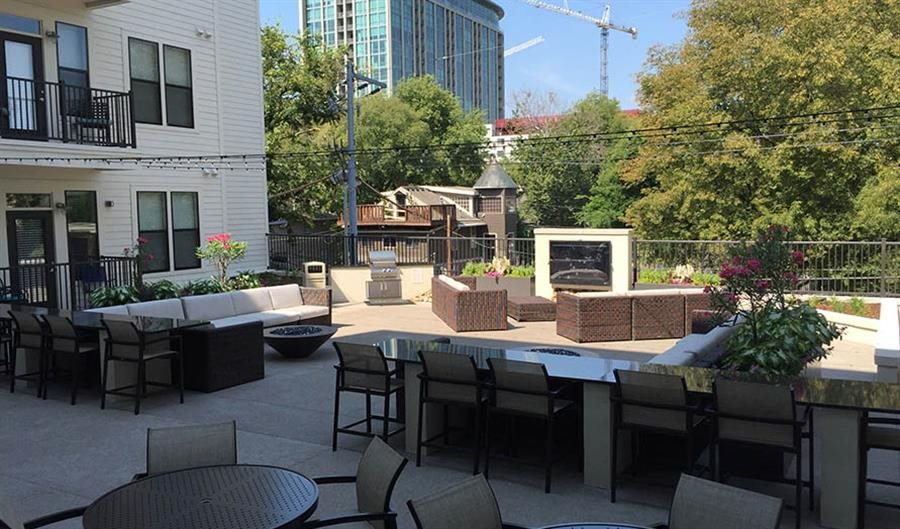 Outdoor social area with fireside retreat Artisan on 18th
