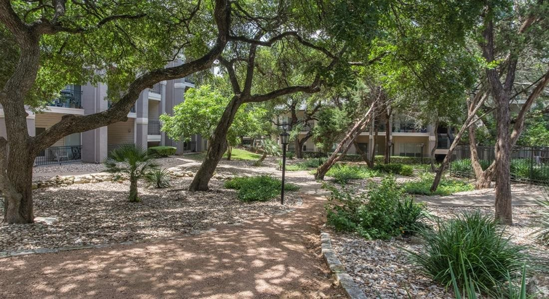 Courtyard With Green Space at San Marin, Austin, 78759