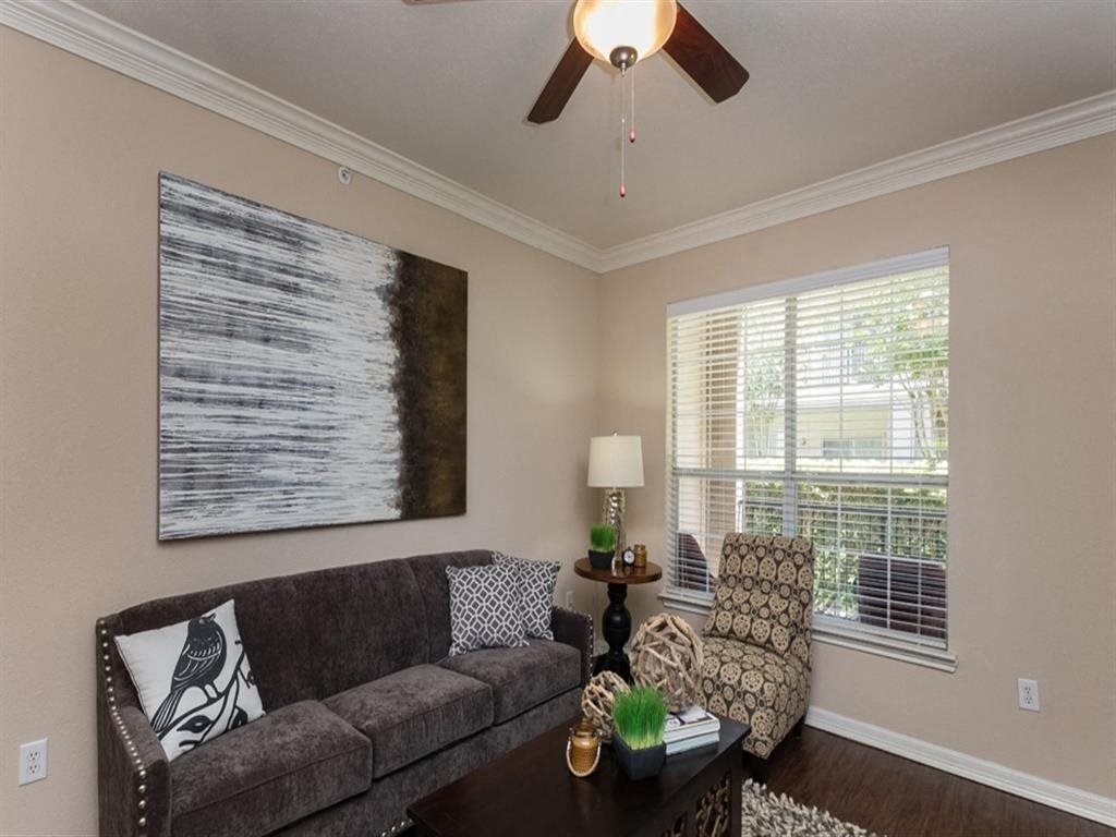 Living Room With Expansive Window at Estates at Bellaire, Houston, Texas