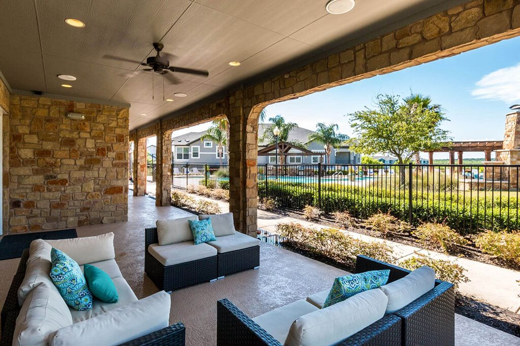 Lounging By The Pool at Villages of Briggs Ranch, San Antonio, 78245
