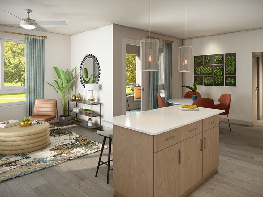 Kitchen island with view of living area at Vita Apartments in Orange, CA