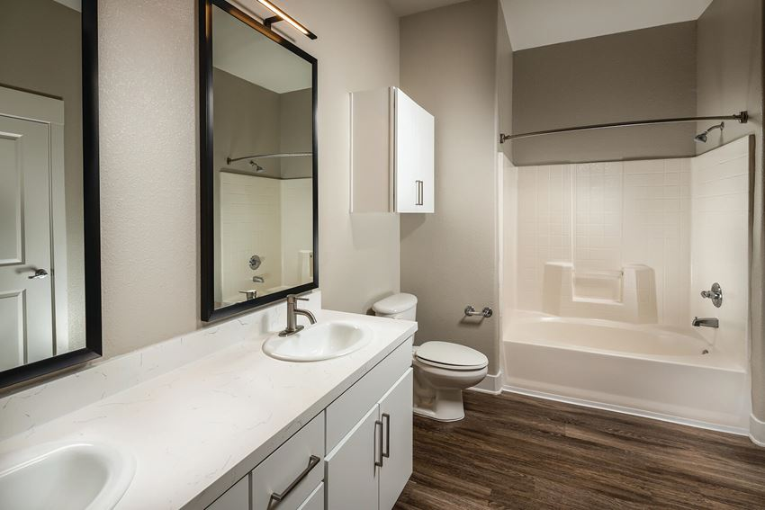 Bathroom with double sinks at The Madison at Town Center Apartments in Santa Clarita CA