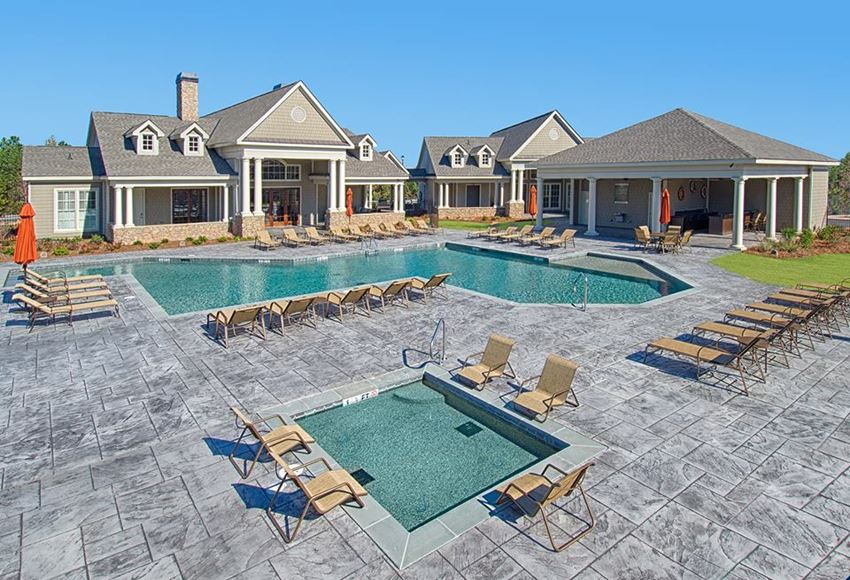 pool with hot tub and sun deck