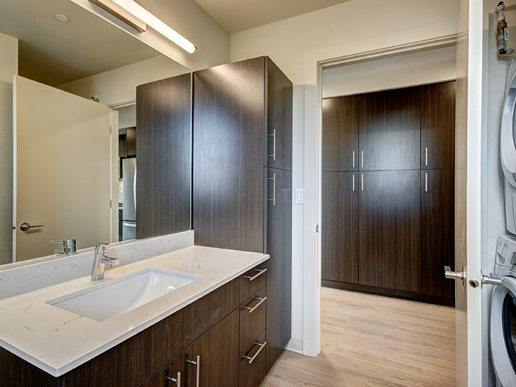 Modern bath with in home washer and dryer