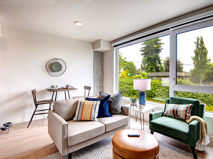 Apartments for Rent in Seattle-Metroline Flats Apartments Living Room With Modern Furnishings And Large Windows