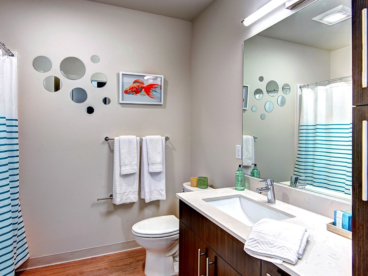 Downtown Seattle Apartments-Metroline Flats Apartments Bathroom With Wood-Style Flooring And White Marble Sinktop