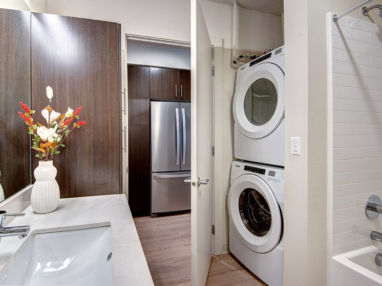full size washer and dryer in bathroom