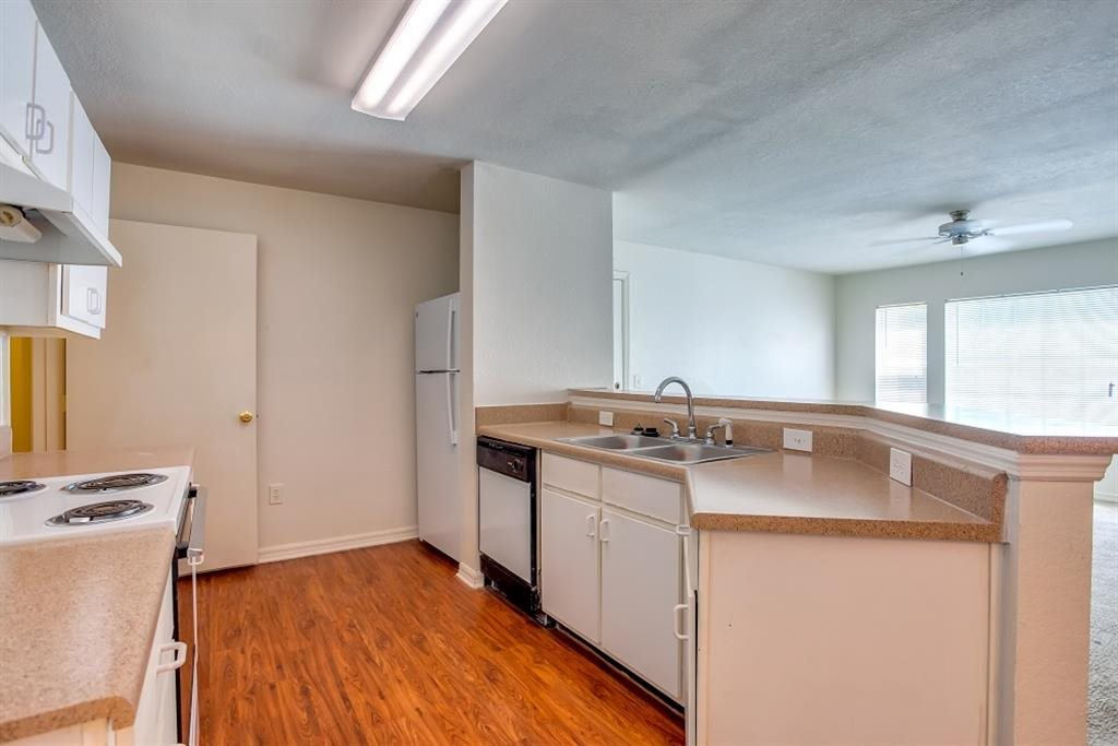 Large kitchen with plenty of counterspace with breakfast bar