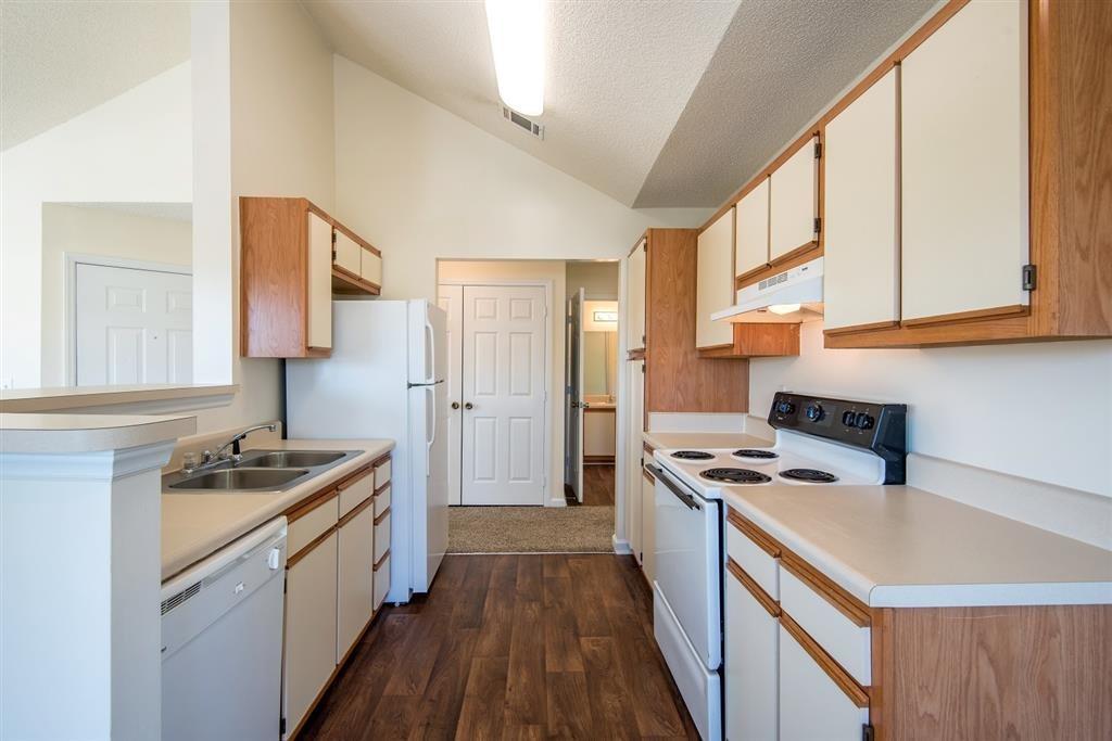 Open kitchen with plenty of cabinet storage