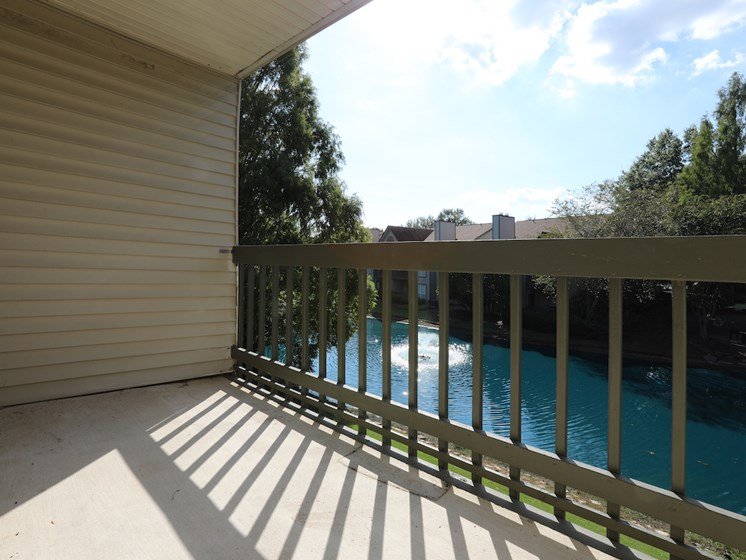 Private Patio with Lake View at Woods of Post House Apartments in Jackson, TN