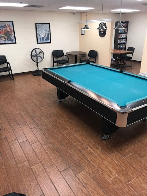 game room with tables and chairs and pool table