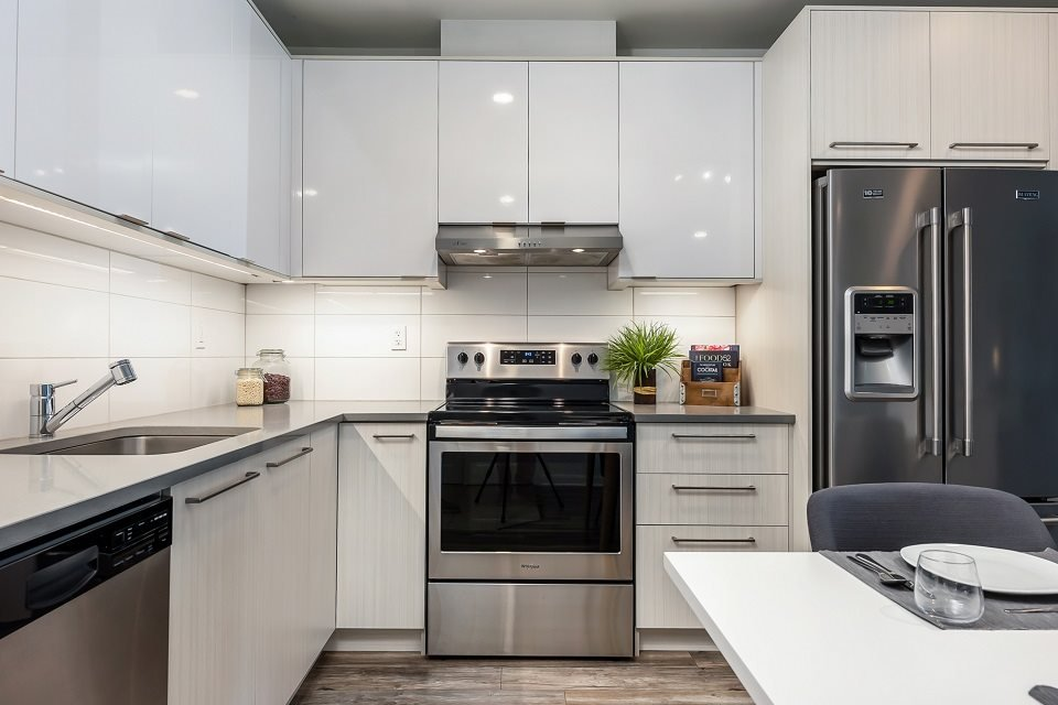Kitchen with Stainless Steel Appliances at Le Saint-Laurent Apartments in Brossard